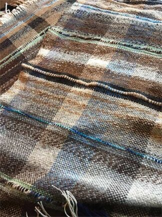 Small, square alpaca fiber blanket in sand and surf colors