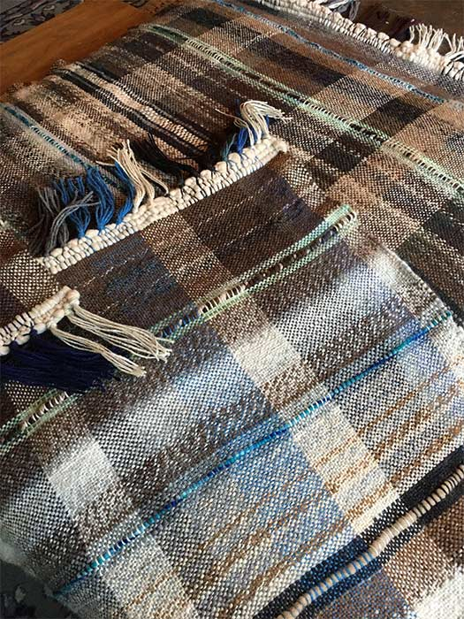 Yarn spun from alpaca fleece makes this blanket lightweight but warm and soft