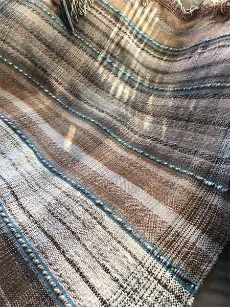 Sublime blanket woven from prime alpaca fleece yarn - close up